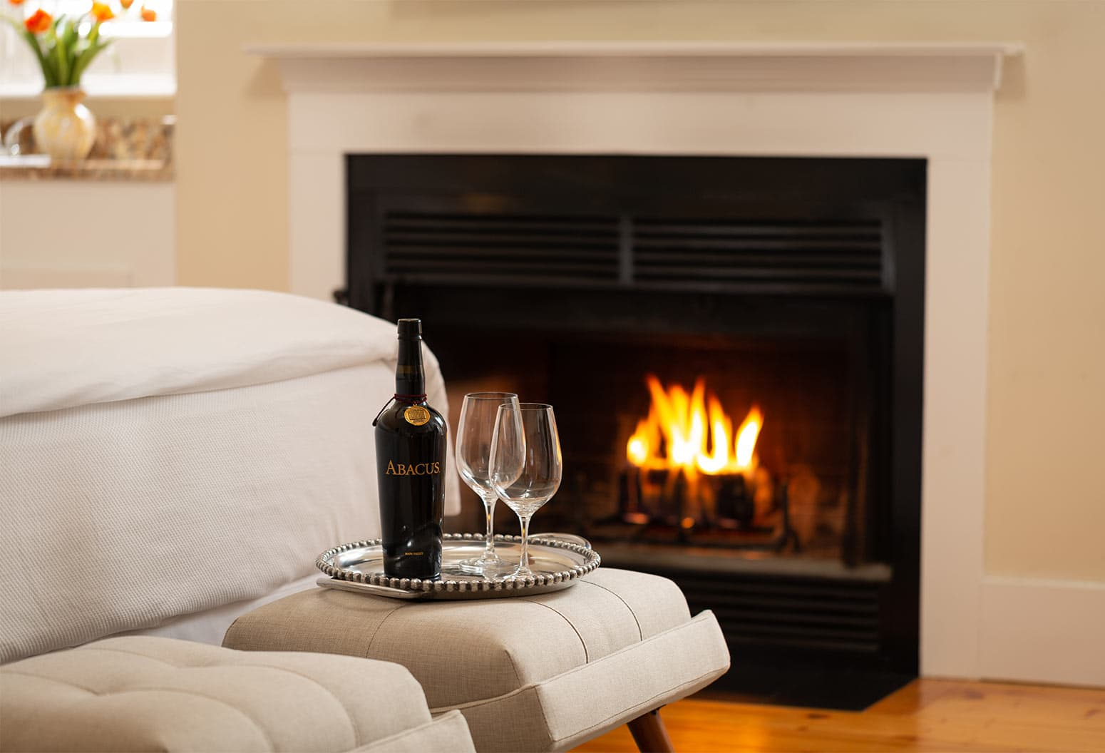 Bottle of Abacus wine with fireplace in background