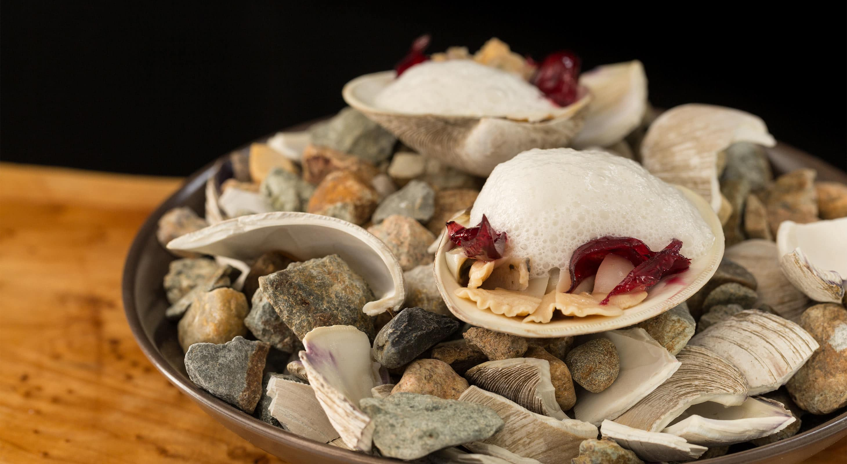 Prepared clams in a bowl with shells.