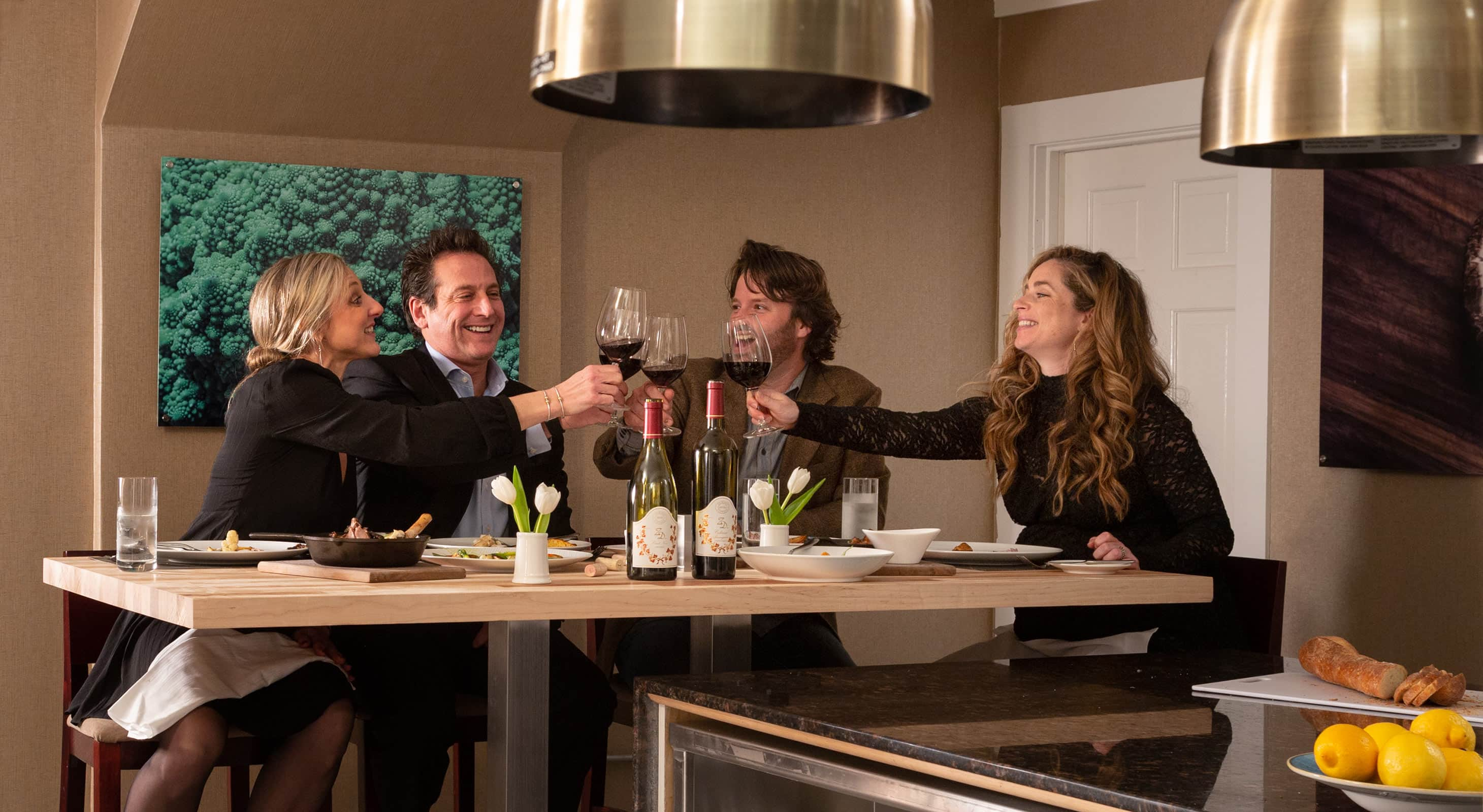 Friends Toasting at the Chef's Table